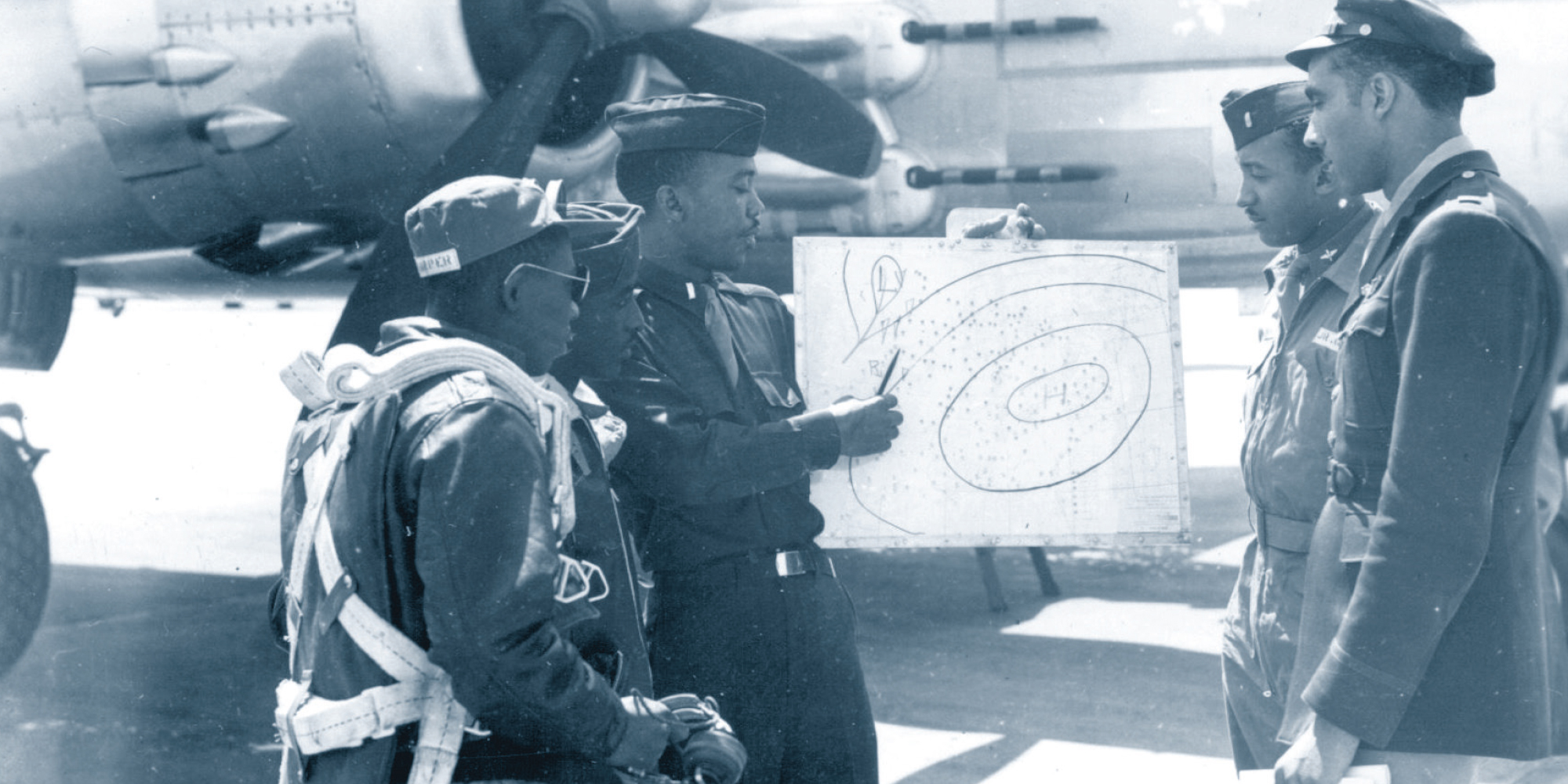 Tuskegee Airmen receiving a weather briefing