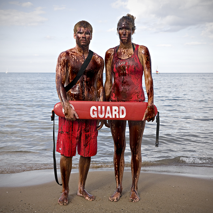 photo of lifeguards covered in oil