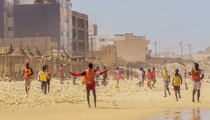 Soccer players at the Plage de Yoff, a beach south of Dakar