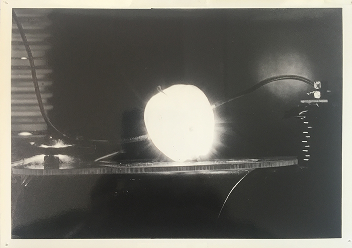 "A photograph of an apple in the ""destructotron"""