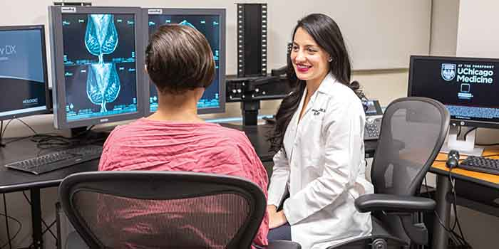 A patient and radiologist discuss breast imaging