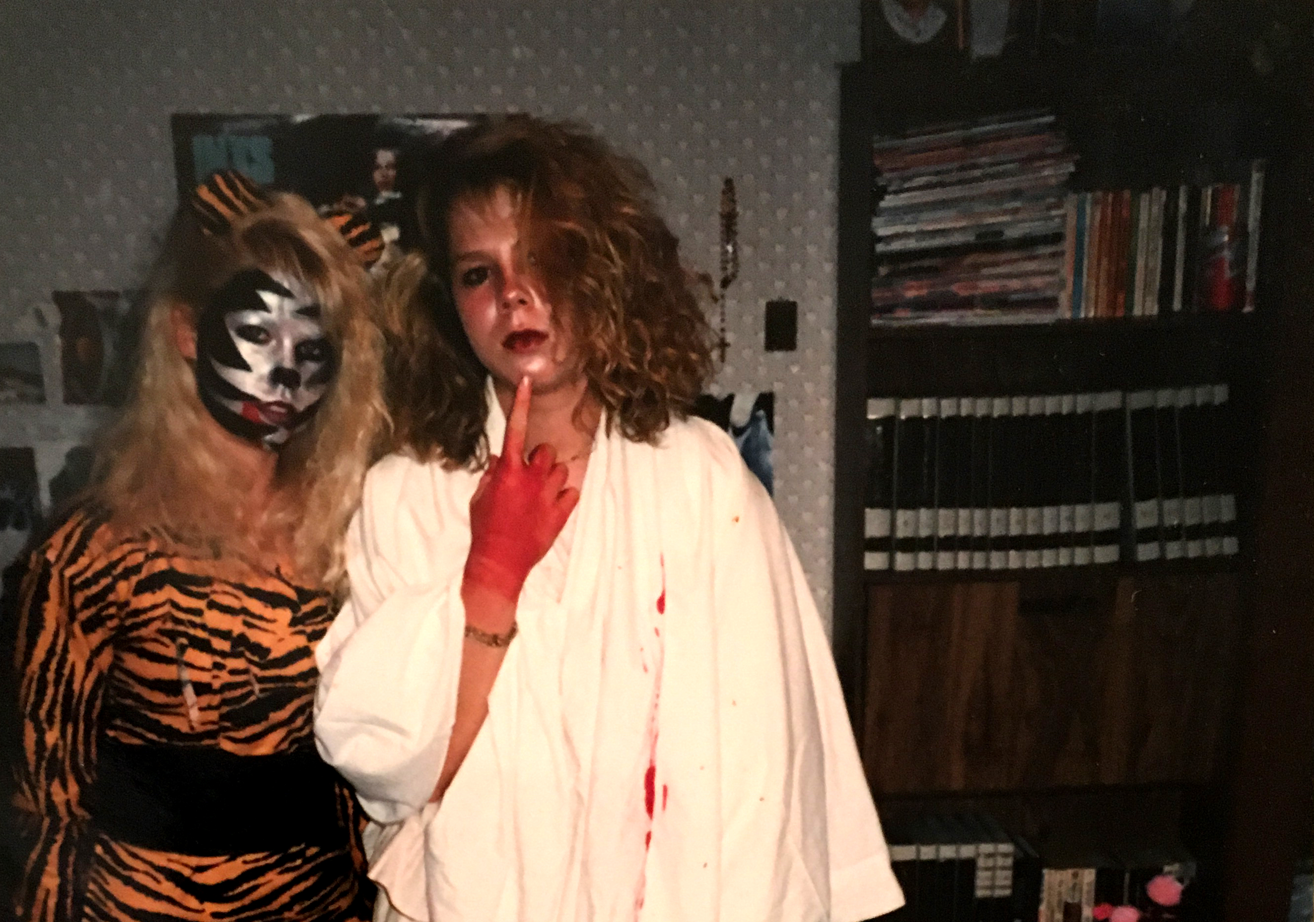 Mattie and cousin Elena in Halloween costumes during high school.