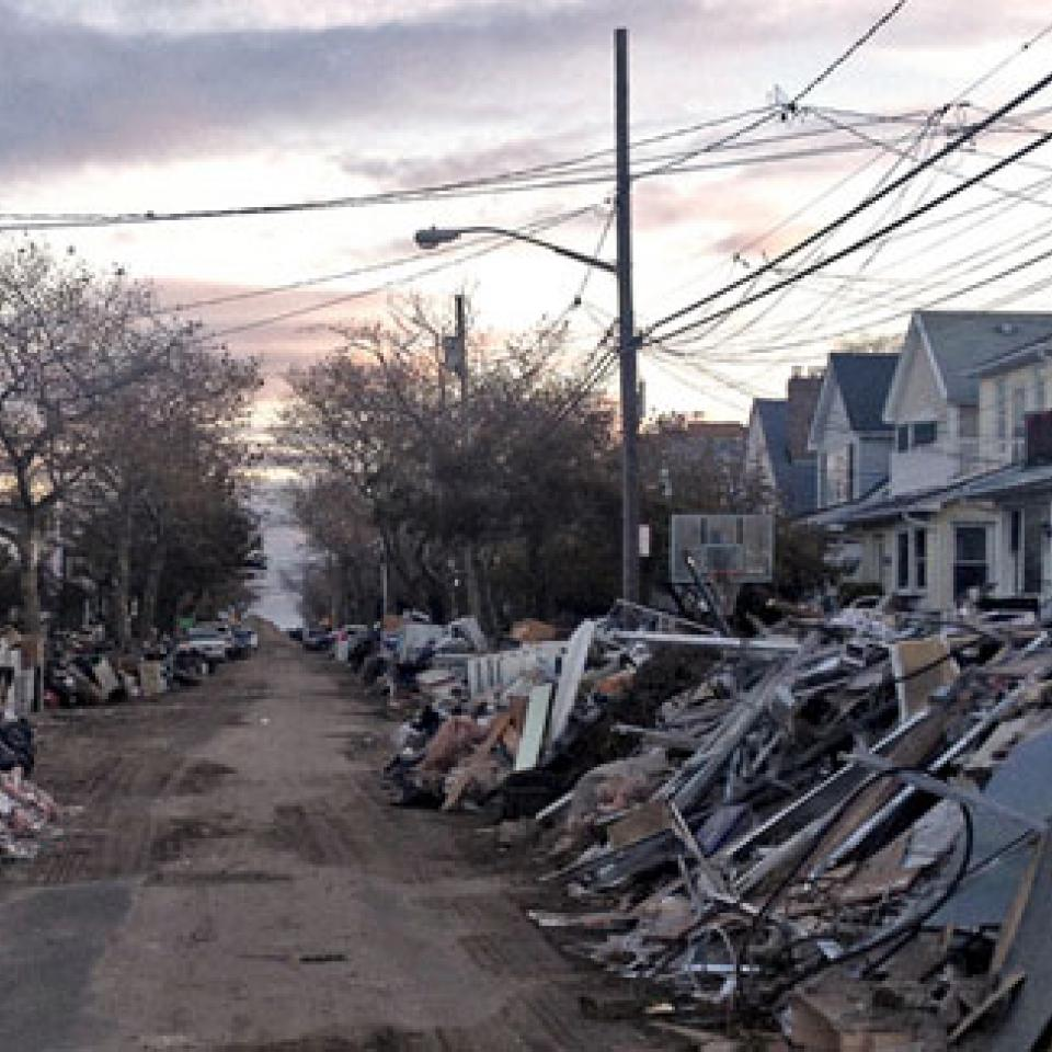 Climate change intensifies the threat to populated coastal areas from storms like Hurricane Sandy.