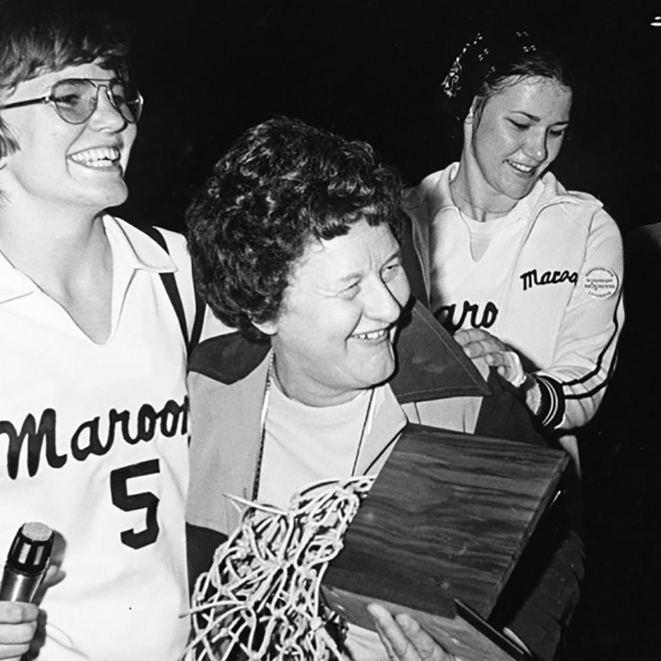 Patrica Kirby with 1976 basketball team cocaptains