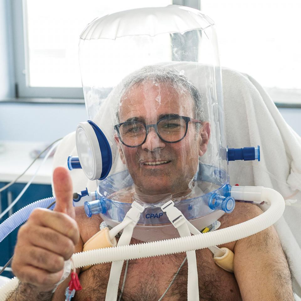 A patient in a ventilation helmet